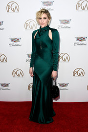 Greta Gerwig slipped into an emerald satin cutout gown by Monse for the 2018 Producers Guild Awards.