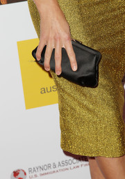 Yvonne Strahovski accessorized with a vintage-chic black frame clutch at the Australians in Film Awards Gala.