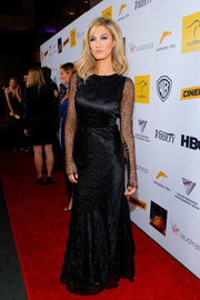 Delta Goodrem looked elegantly dramatic in a black Johanna Johnson evening dress with sheer sleeves when she attended the Australians in Film Awards Gala.