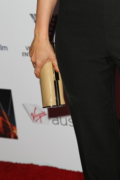 Radha Mitchell attended the Australians in Film Awards Gala carrying an elegant nude tube clutch.
