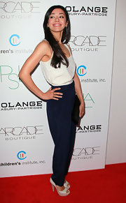 Aimee Garcia finished off her look with platform peep-toe pumps.