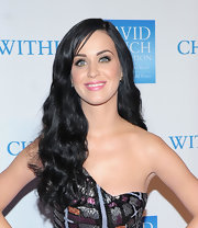 Katy Perry added a little length to her 'do and showed off soft curls with a sleek side part.
