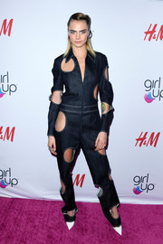 Cara Delevingne went playful in a Guy Laroche denim jumpsuit with multiple circular cutouts at the 2019 Girl Up #GirlHero Awards.