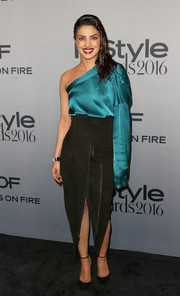 Priyanka Chopra paired her chic blouse with an edgy front-slit suede skirt, also by Haider Ackermann.