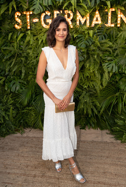 Nina Dobrev looked fetching in her white Altuzarra summer dress at the Maison St-Germain event.