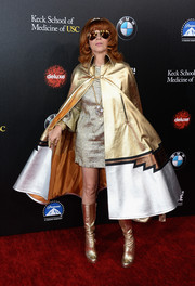 Linda Ramone made a grand entrance in a gold and silver cape during the Rebels with a Cause Gala.
