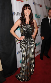 At the 2nd Annual Thirst Project Gala, Chyler Leigh was an architectural vision in this Empire State gown from the Fall 2011 collection.