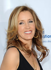 Felicity Huffman wore her golden tresses in soft wispy layers while attending the second annual Wisteria Lane block party.