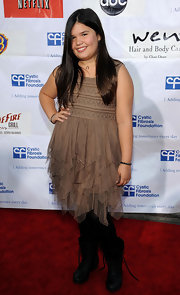 Madison looked chic in her brown ruffled dress over black tights.