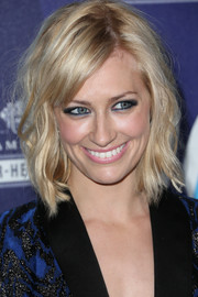 Beth Behrs framed her face with a chic way cut for the 2015 unite4:humanity event.
