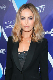 Changing up her usual dark locks, Camilla Belle wore a wavy blonde 'do at the unite4:humanity event.