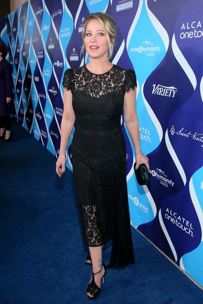 Christina Applegate complemented her dress with black ALDO T-strap peep-toes with bedazzled straps.
