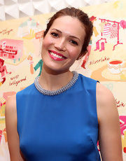 Mandy Moore added bright bursts of color with a brilliant blue dress and pop of shiny fuchsia lipstick.