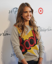 Jessica Alba kept it casual in a graphic-print crewneck sweater at the 3.1 Phillip Lim for Target launch event.
