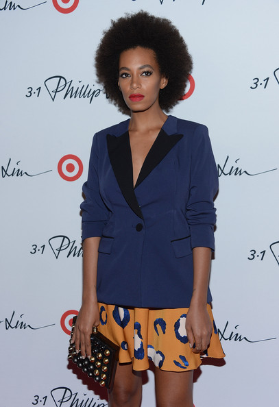 Solange Knowles finished off her ensemble in modern style with a box clutch featuring metal embellishments.