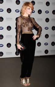 Nicola Roberts paired an avant-garde velvet jumpsuit with strappy gold sandals.