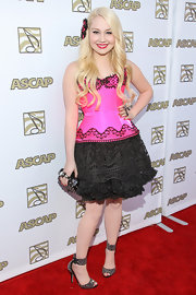 RaeLynn showed off her country glam side with this pink corset dress with a ruffled black lace skirt.