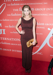 Kate Upton went for simplicity with this sleeveless wine-colored Azzedine Alaia dress at the Annual Night of Stars.