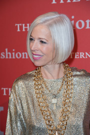 Linda Fargo glowed from head to toe at the Annual Night of Stars with her platinum blond bob and gold outfit.