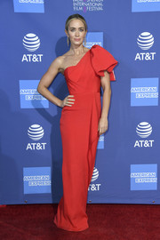 Emily Blunt went the ultra-feminine route in a red one-shoulder column dress by Roland Mouret at the 2019 Palm Springs International Film Festival Awards Gala.
