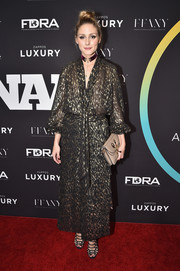 Olivia Palermo donned a black and gold tie-neck blouse from her Chelsea28 collection for the FN Achievement Awards.