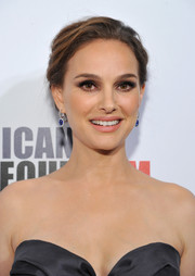 Natalie Portman polished off her look with a pair of dangling sapphire earrings.