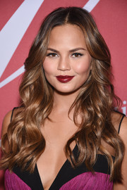 Chrissy Teigen finished off her look with a striking red lip.