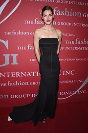 Hilary Rhoda looked simply elegant at the FGI Night of Stars event in a black strapless gown with white trim and a long train.