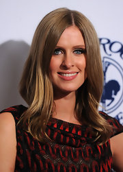 Nicky Hilton sticks to her signature hairstyle when walking the red carpet. Her center part locks work well for the socialite.