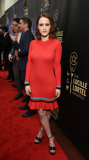 Rachel Brosnahan flaunted her figure in a red ruffle-hem sweater dress at the Lucille Lortel Awards.