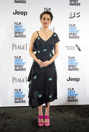Jenny Slate added a bright spot with a pair of hot-pink broad-strap mules by Stuart Weitzman.