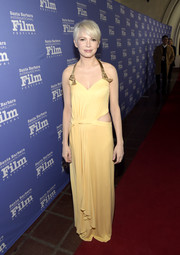 Michelle Williams brightened up the red carpet with this yellow cutout halter gown by Louis Vuitton during the Santa Barbara International Film Festival.