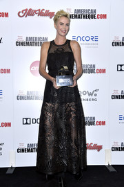 Charlize Theron rocked a black laser-cut leather gown by Dior at the 2019 American Cinematheque Award.