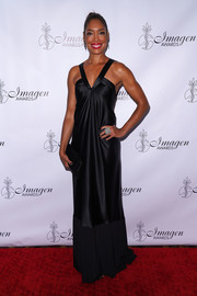 Gina Torres looked elegant in a black V-neck satin gown at the Imagen Awards.