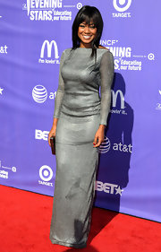 Tatyana Ali donned a sparkling silver backless gown for the UNCF An Evening of Stars Event. A box clutch completed her look.