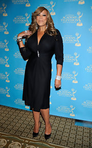 Wendy Williams stuck to an all black look at the Emmy Awards. She paired her knee-length dress with satin pumps.