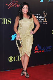 Rachael Ray paired her sparkling draped dress with a gold box clutch.