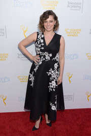 Rachel Bloom was the picture of elegance in a black wrap dress with white floral embroidery at the College Television Awards.