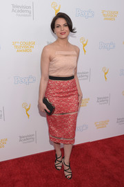 Lana Parrilla looked alluring at the College Television Awards in a nude and red lace dress with illusion panels.