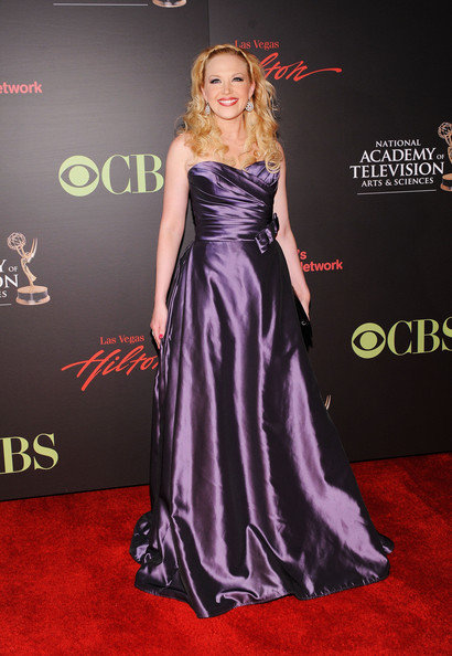 Adrienne shined on the Emmy red carpet in a purple strapless evening gown.