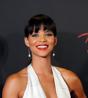 Denise Vasi went classic with her accessories as she wore a pair of pearl drop earrings at the Emmys.