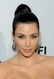 Kim showed off her stunning earrings and sleek high bun at the Fifi Awards.