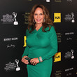 Catherine Bach's figure-hugging green dress