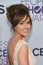 Nikki Deloach really brought it on the 2013 People's Choice Awards red carpet with this higher-than-heaven hairdo.