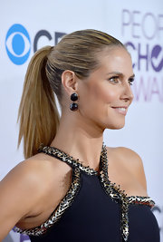 Heidi Klum pulled her hair up high and tight into a super-slick ponytail for the 2013 People's Choice Awards.