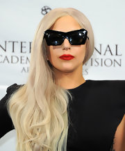Lady Gaga livened up her black ensemble with a pop of fiery red lipstick at the 39th International Emmy Awards.