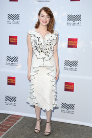 Emma Stone went the frothy route in a white Rodarte lace dress with black trim and ruffle detailing during the Mill Valley Film Festival opening.
