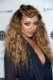 Kat Graham worked a mussed-up wavy 'do with a fishtail-braided top at the 3rd Annual Beautycon Festival.