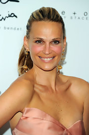 Molly Sims paired her slick ponytail with gold dangle earrings with gemstones at the ends.