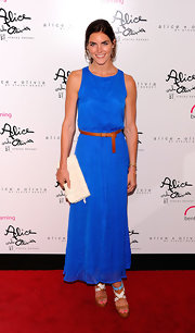 Hilary paired her platform sandals with a cobalt blue evening gown that was cinched at the waist with a tan belt.